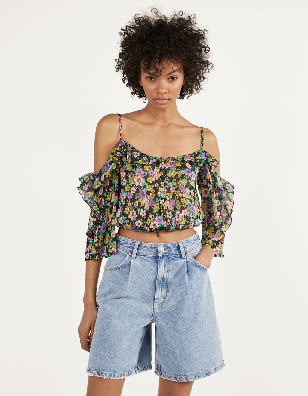Blusa cut out con estampado de flores