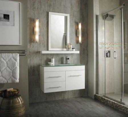 Baño gris con muebles blancos.