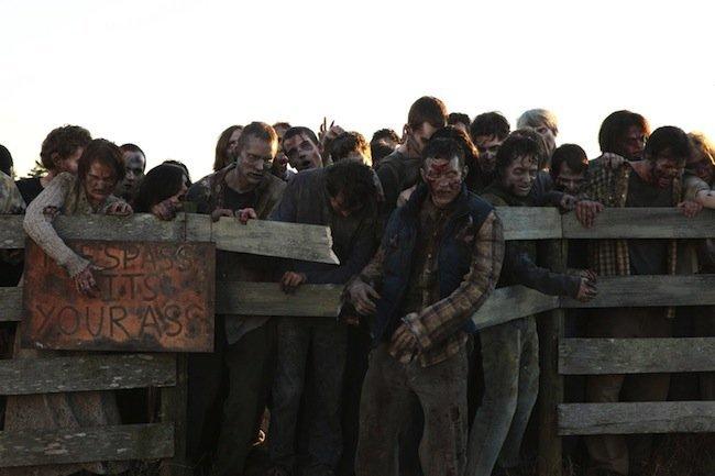 the-walking-dead-season-two-finales-walkers-breaking-through-fence.jpg