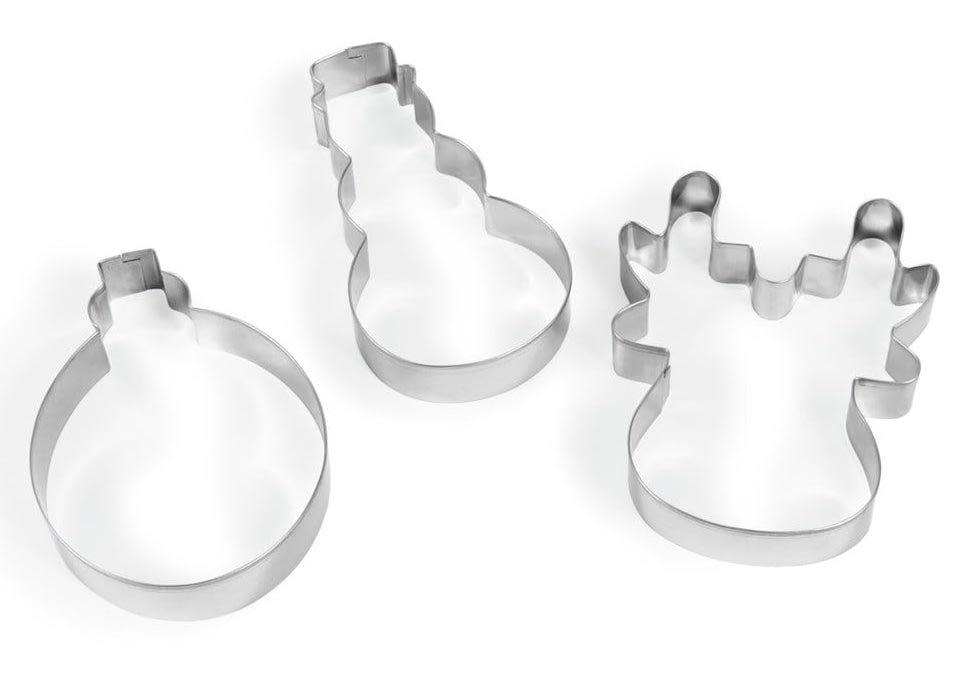 Tres moldes de metal