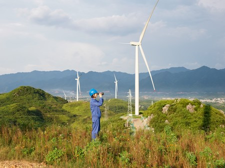 China Clean Energy Fund Invests In Wind Farms Team Member Looking Across Landscape 082619