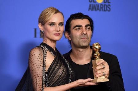 Diane Kruger y Fatih Akin con el Globo De Oro por En La Sombra