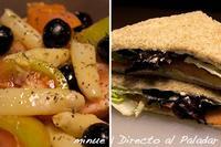 Comida para llevar. Ensalada de tomate con espárragos y sándwich de salmón ahumado