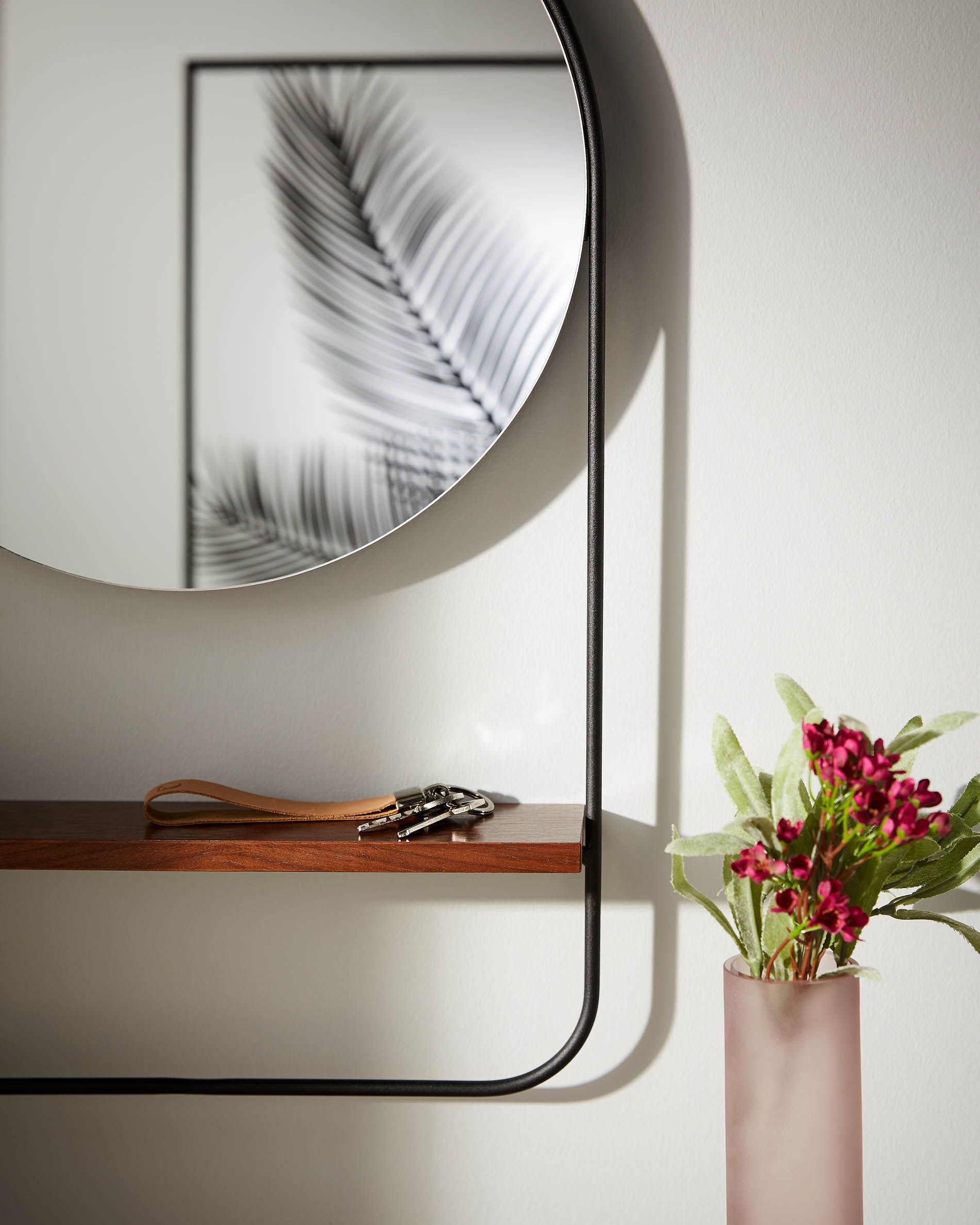 Espejo redondo con estantería incorporada