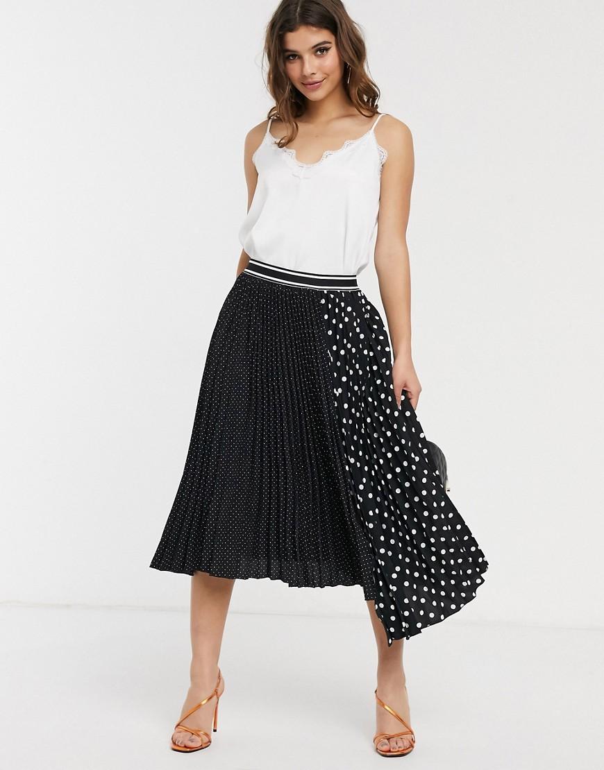 Falda midi plisada con estampado en contraste y lunares.