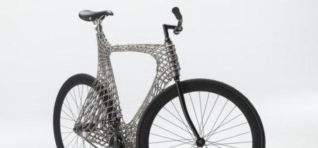 """Brazos robóticos que """"imprimen"""" puentes, también pueden con bicicletas: Arc Bicycle"""