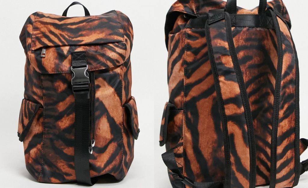 Mochila con estampado de tigre y bolsillos laterales de nailon de ASOS DESIGN