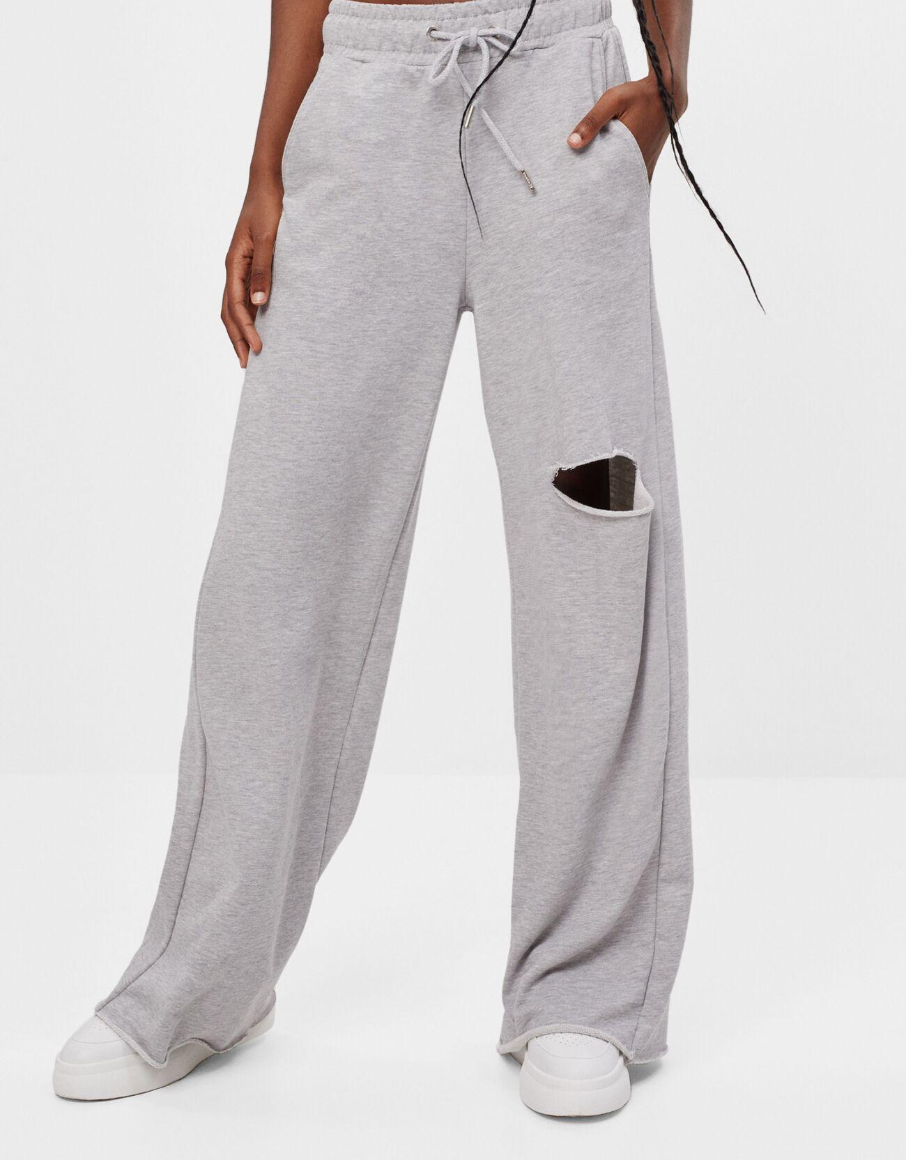 Pantalón de chándal ancho con roto en la rodilla