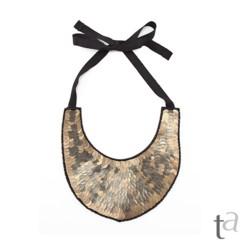 Foto 11 de 19 de la galería decora-tu-cuello-con-los-collares-babero-1 en Trendencias