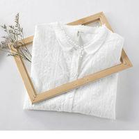 Camisa blanca con bordados por 12,27 euros y envío gratis en el aniversario de Aliexpress