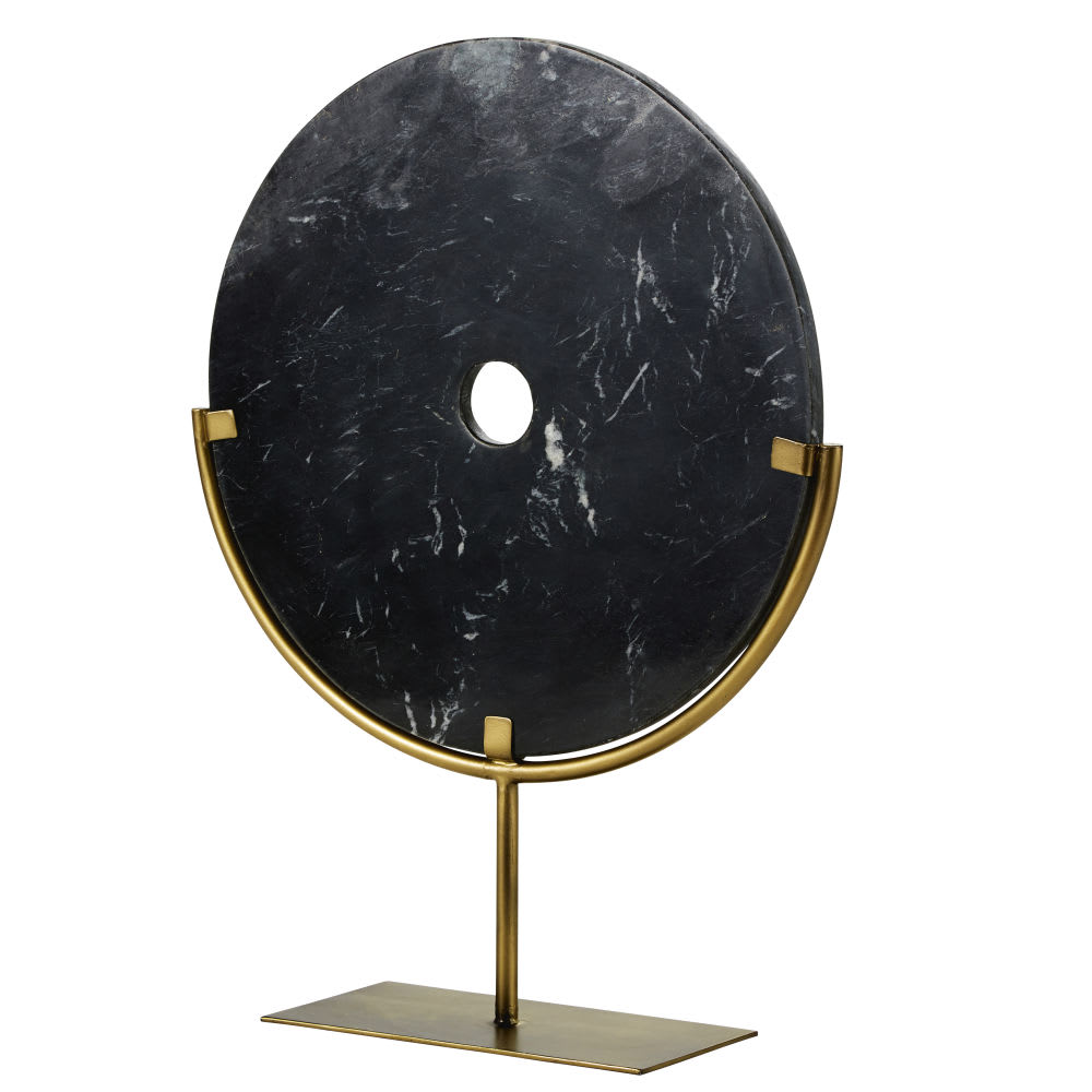 Estatua de círculo de mármol negro y metal dorado