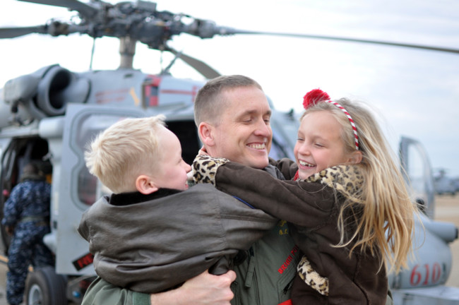 Us Navy 111210 N Fu443 288 A Sailor Hugs His Son And Daughter During The Squadron S Homecoming Ceremony