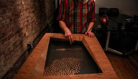 Una pantalla táctil de agua para peces virtuales