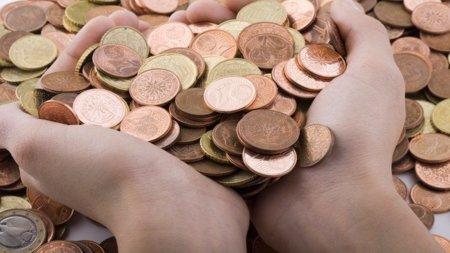 monedas mano