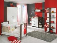Un dormitorio de bebé en rojo
