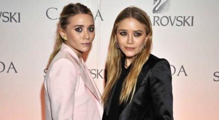 Dos formas diferentes de lucir un traje, por las gemelas Olsen