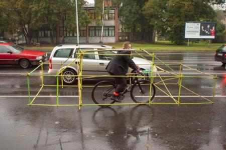 Cyclists Wear Car Frame Latvia Riga Designboom 11 1