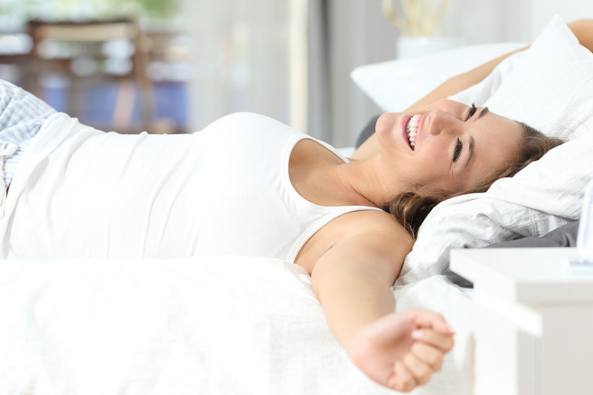Little Boy Waking Up Stretching In Bed Stock Photo