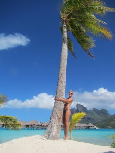 Nada mejor que decir adiós a las vacaciones que en topless, ¿verdad Heidi Klum?