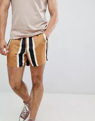 Pantalones de corte slim a rayas colour block de ASOS DESIGN