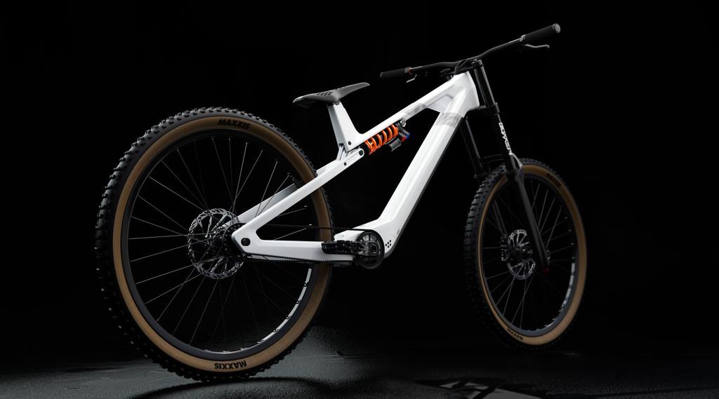 Esta bicicleta eléctrica de descenso tiene un peculiar diseño: sin tubo vertical, con indicadores LED y con el motor escondido