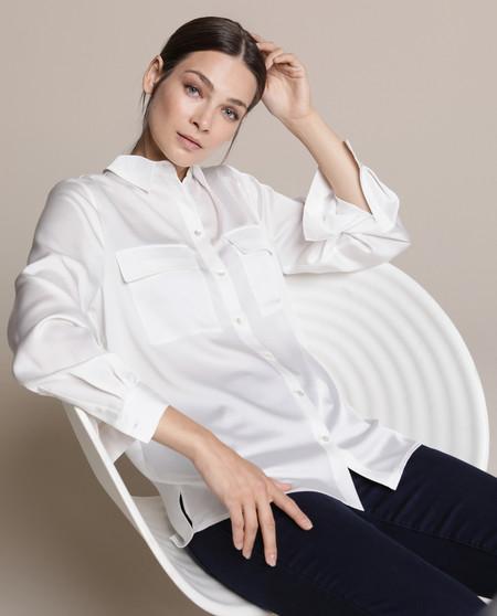 Blusa de mujer en satén con bolsillos