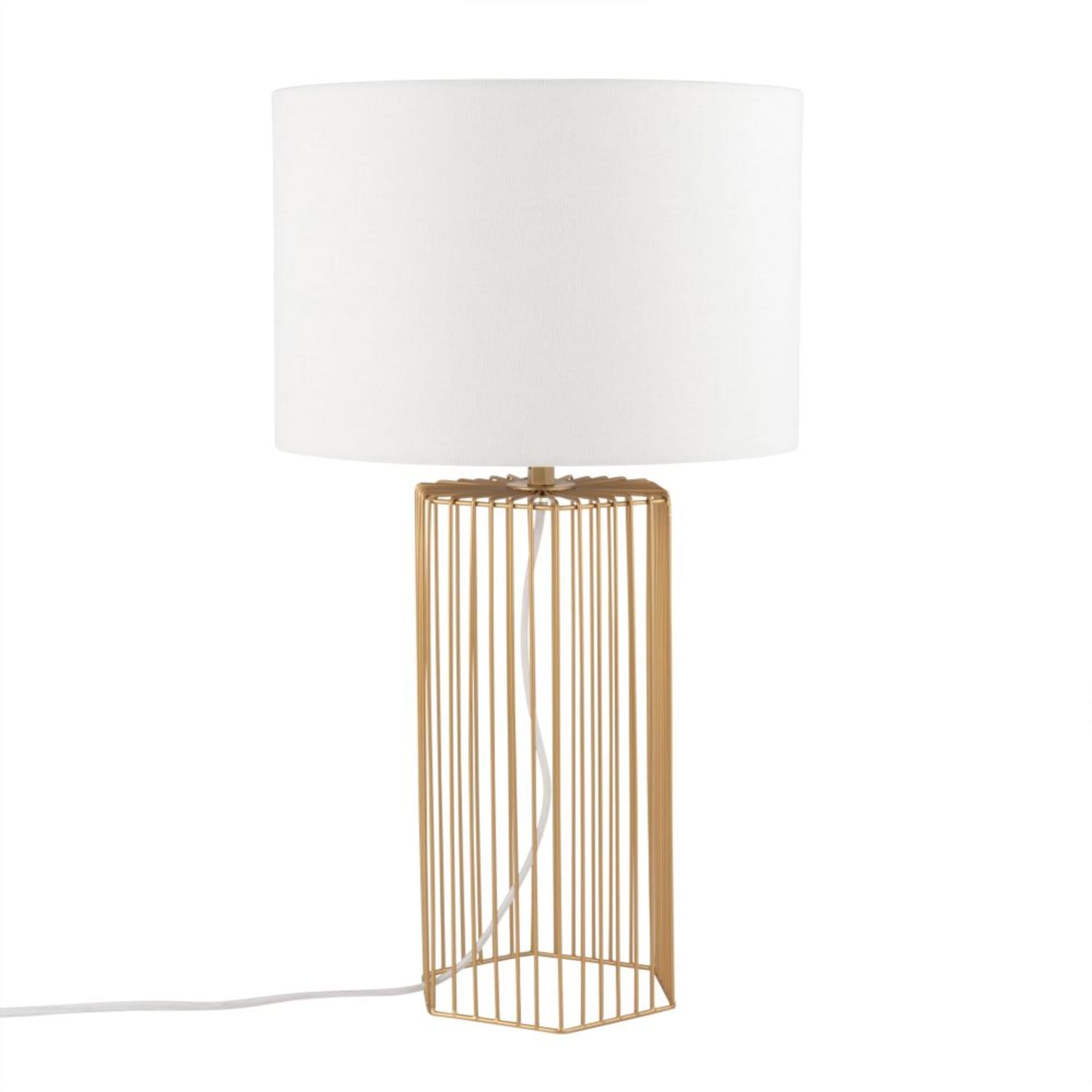 Lámpara de metal dorado y pantalla blanca