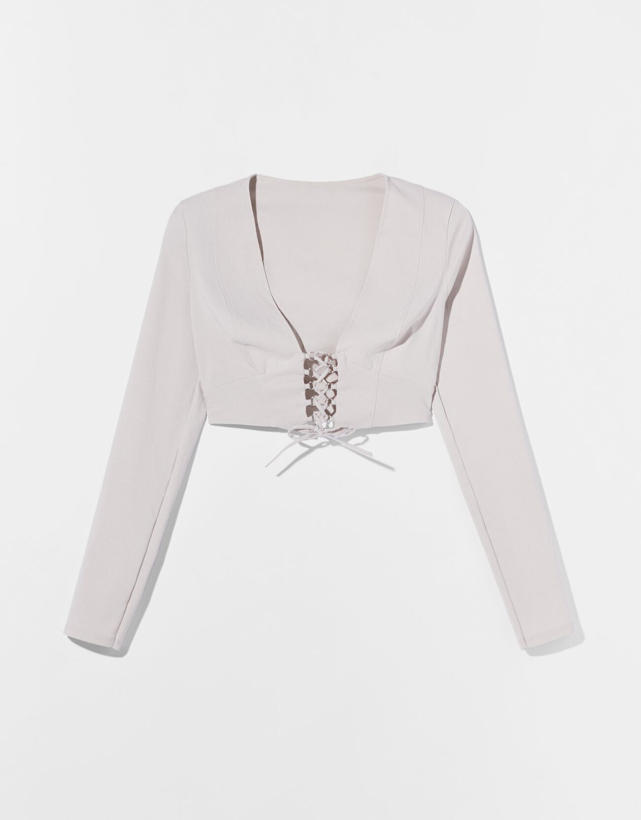 Blusa de manga larga con corset.