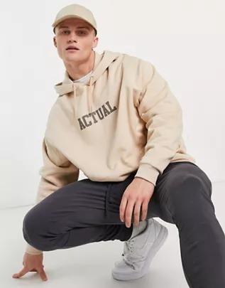 Sudadera color arena extragrande con capucha y logo universitario a tono estampado en la parte delantera de ASOS Actual