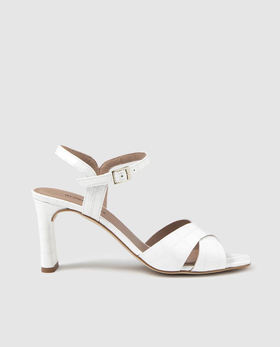 Sandalias de tacón de mujer Gloria Ortiz de piel blanca con adorno de tiras cruzadas