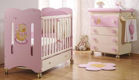 Una habitación rosa con ositos.