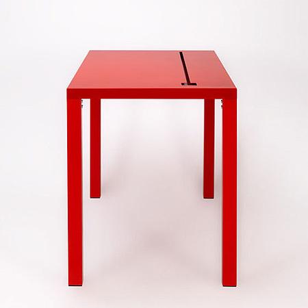 Una mesa con escondite para cables