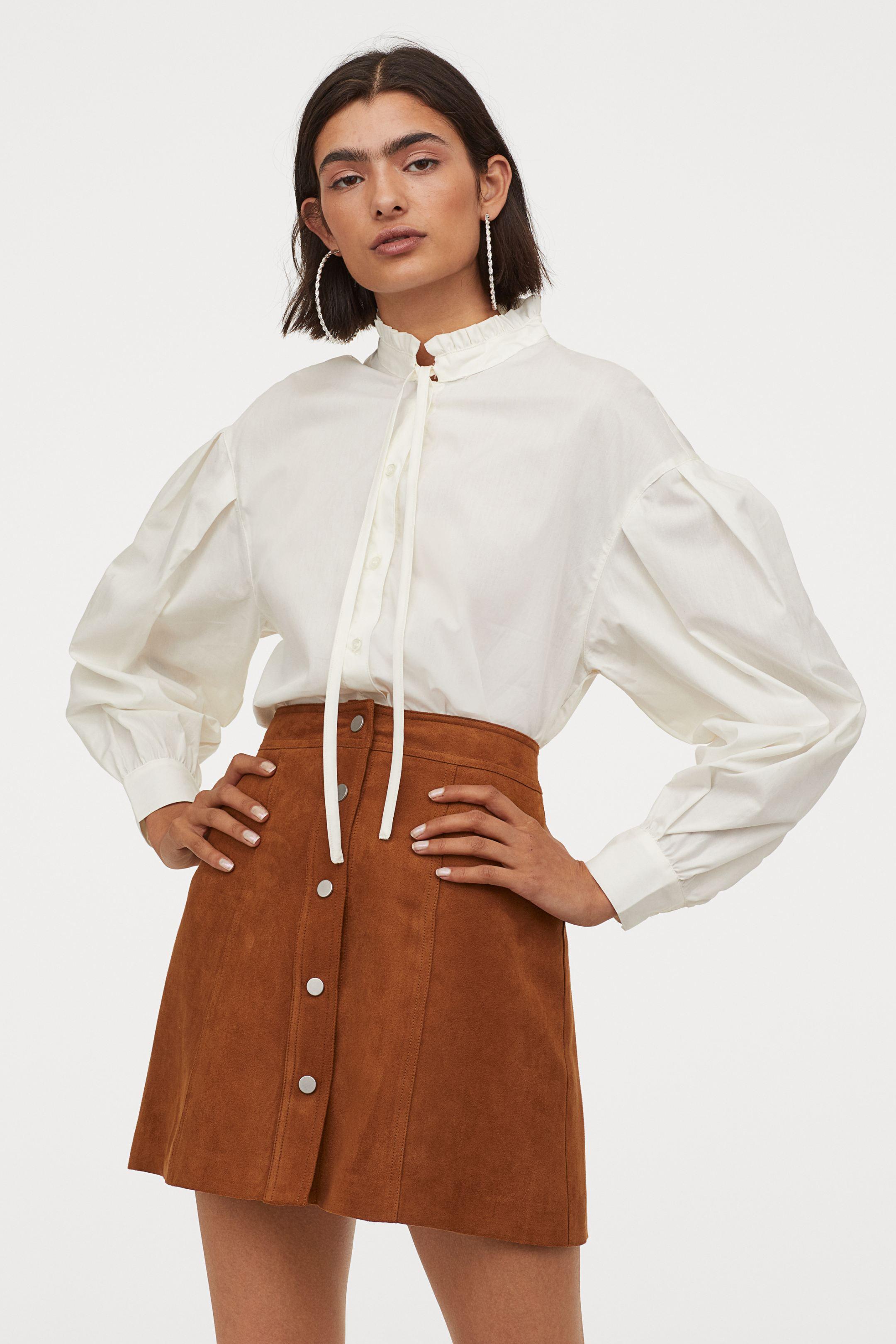 Blusa amplia con lazada y mangas abullonadas