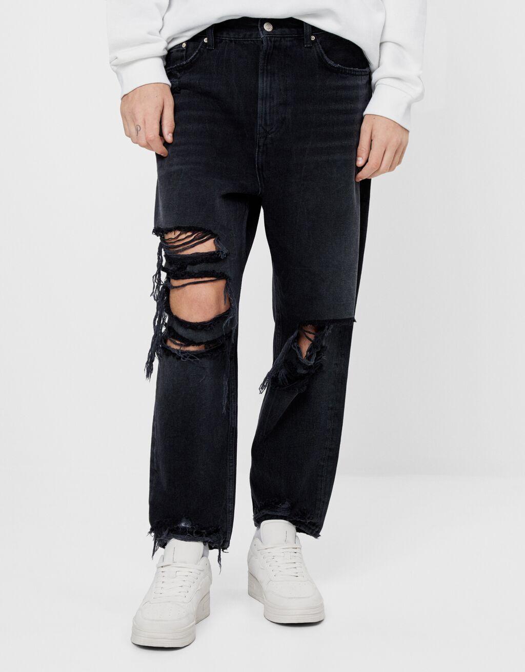 Jeans loose con efecto roto
