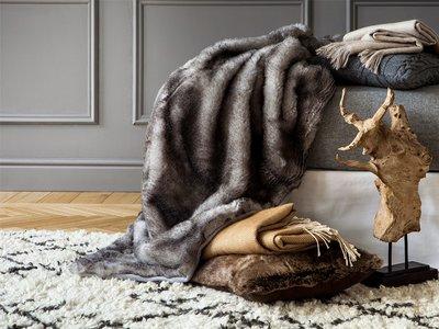 Crea espacios acogedores: Diecinueve mantas de sofás para otros tantos estilos decorativos