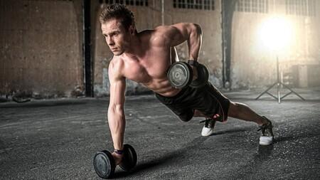 exercice musculaire avec haltère abdos et bas du dos