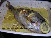 Receta de Besugo al horno sobre una cama de patatas