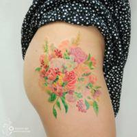 Los bellos y delicados tatuajes de una artista coreana
