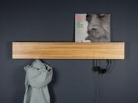 Un colgador secreto, oculto en un estante, ideal para ambientes minimalistas