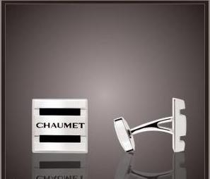 Una colección de gemelos Chaumet con estilo y anillo masculino