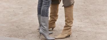 Las botas altas se llevan por encima del pantalón (ancho). Palabra del street style