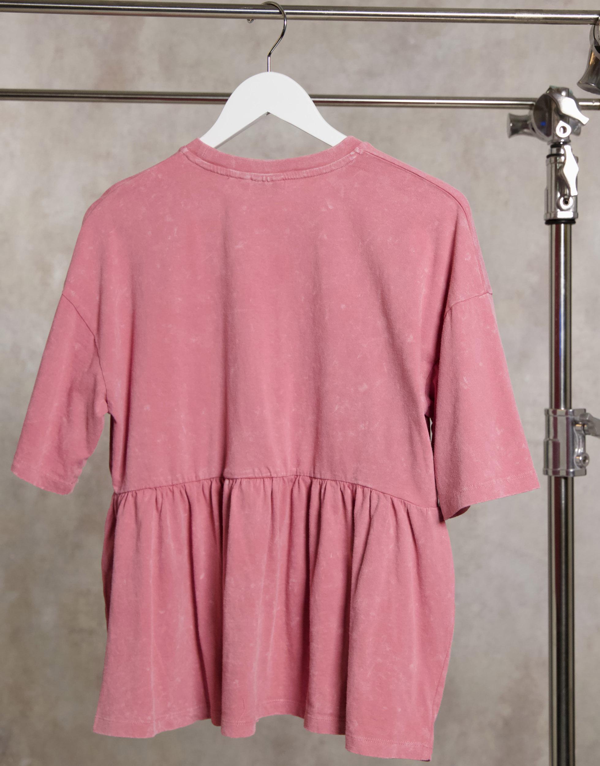 Blusón en lavado ácido de color rosa sombra