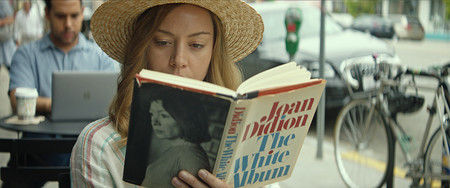 Ingrid Aubrey Plaza Reads In A Public Place In Ingrid Goes West Courtesy Of Neon