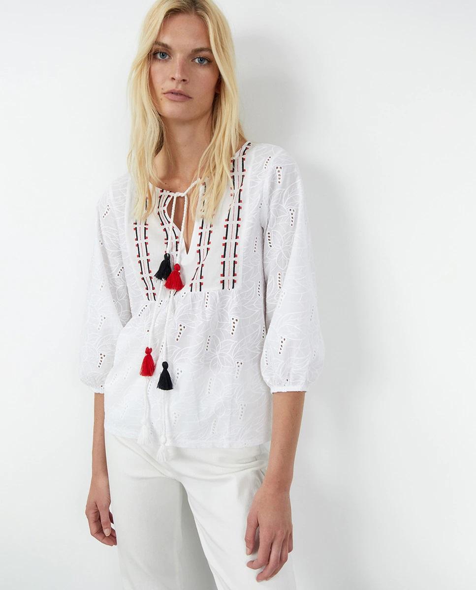 Blusa boho-chic holgada con bordados y borlas de Sfera
