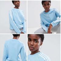 Esta sudadera Adidas Original con las clásicas bandas laterales tiene 20% de descuento y envío gratis en ASOS