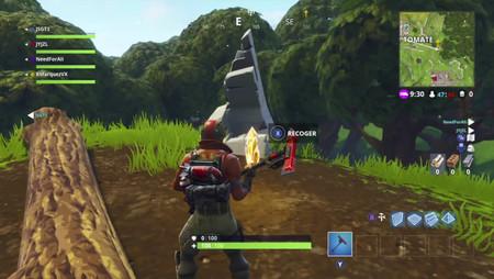 Guía Fortnite Battle Royale: busca entre un círculo de piedra, un puente de madera y una caravana roja