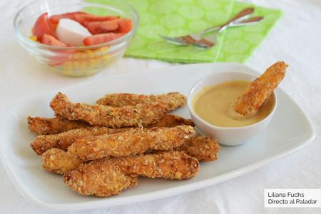 Fingers de pollo al horno con salsa de yogur y mostaza: receta de picoteo crujiente