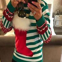 ¿Se te hace duro soportar las comidas navideñas? Quizá este jersey con botella de vino incorporada sea la solución