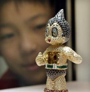 """Estatuilla de """"Astro Boy"""" con diamantes, rubíes, y esmeraldas"""