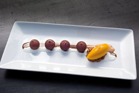 liquid chocolate bombons with mango sorbet